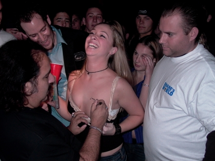 Ron Jeremy autographing breast