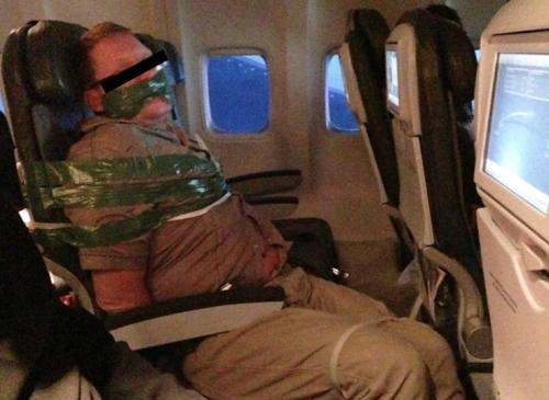 Drunk passenger restrained